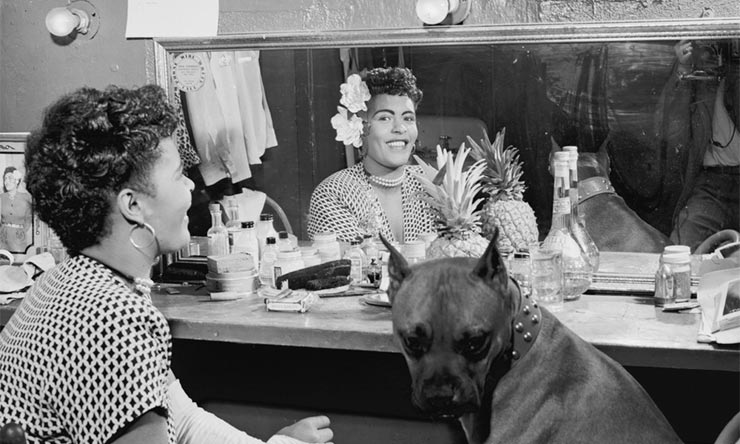 Billie Holiday with her dog, Mister, backstage at the Downbeat Club, New York, June 1946. Photo: Library Of Congress