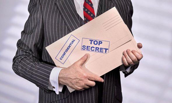 Guilty pleasures header image, man with top secret folder