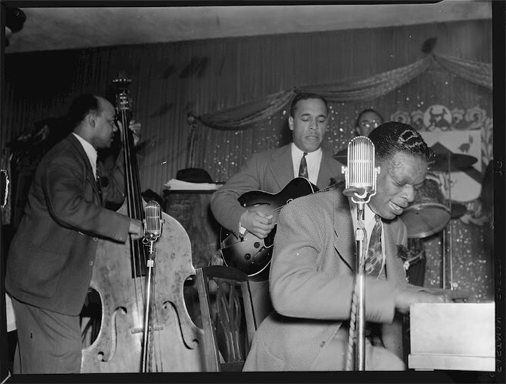 Wesley Prince (bass), Oscar Moore (guitar), and Nat King Cole, at The Café Zanzibar, 1946