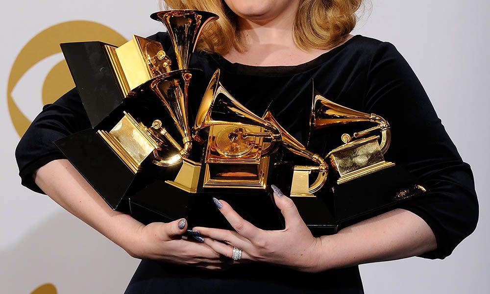 Adele holding Grammys