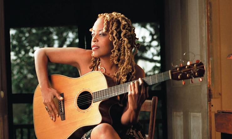 Cassandra Wilson playing guitar