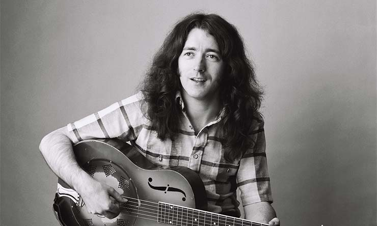 Rory Gallagher playing guitar