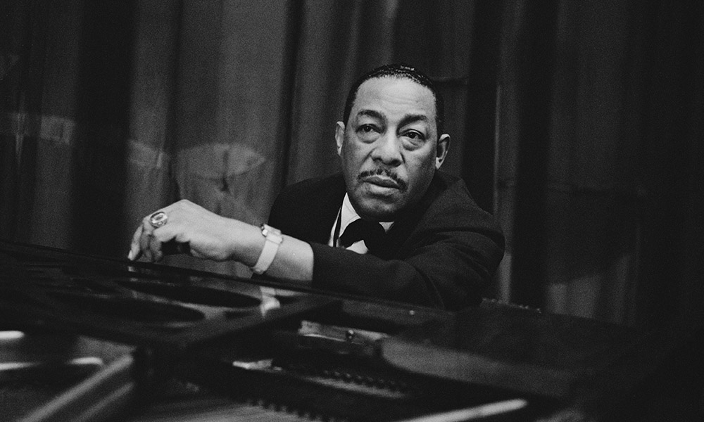 Johnny Hodges at a piano