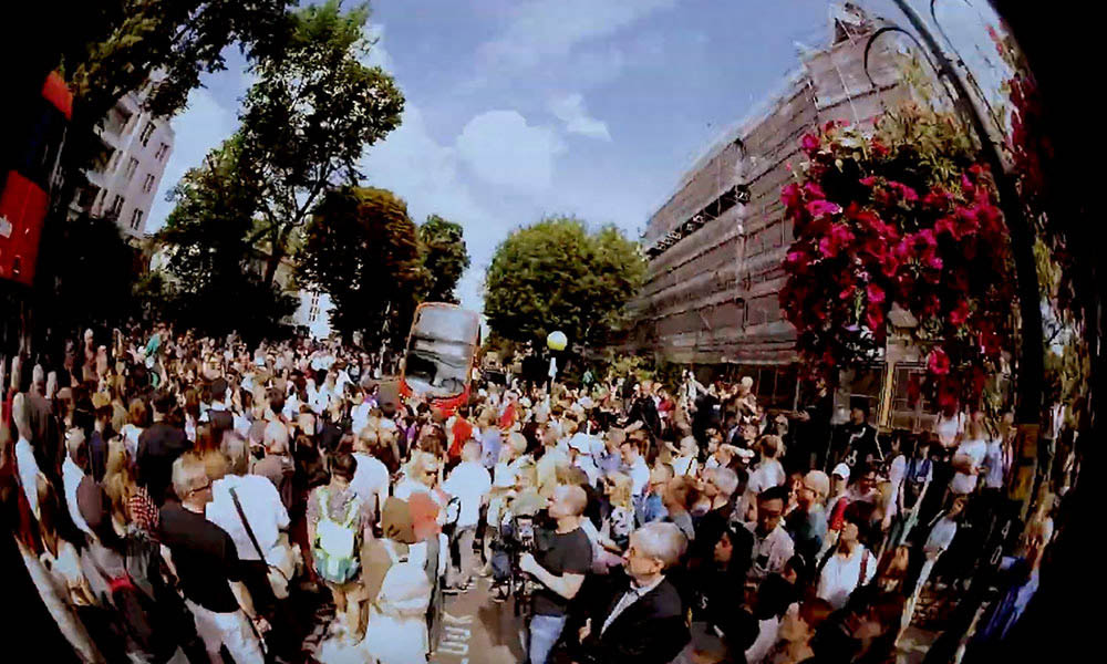 Watch Beatlemania Descend On Abbey Road To Mark 50th Anniversary Of Iconic Album Cover Shoot
