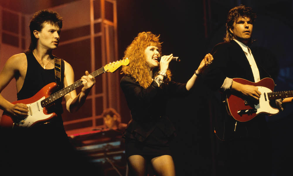 """We're Part Of The 80s Fabric"": Carol Decker And Ronnie Rogers Talk T'Pau"