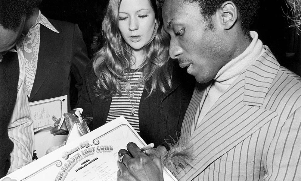 Jimmy Cliff signing The Harder They Come album, the soundtrack to one of the greatest films about reggae