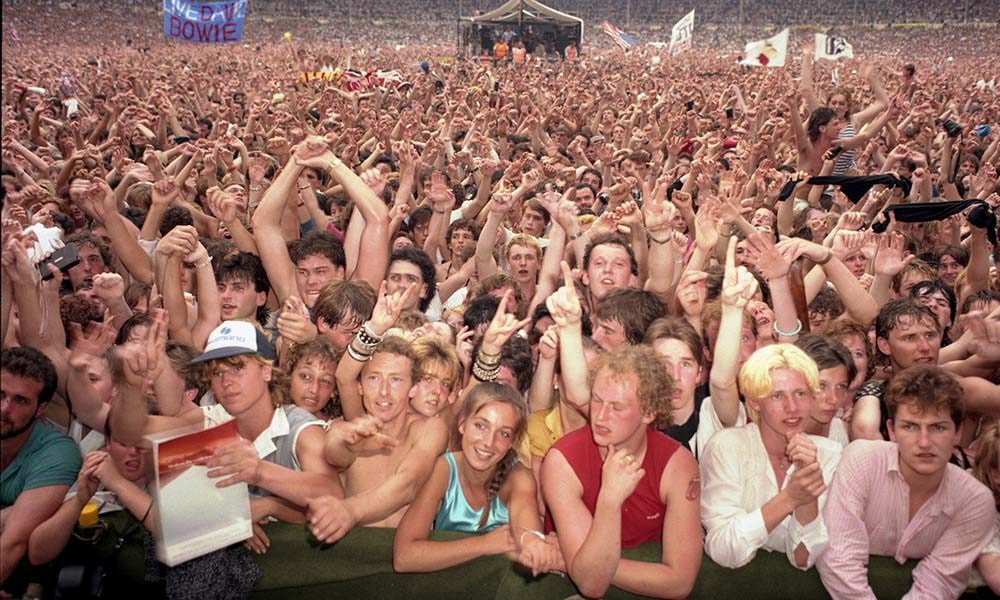 View of the cheering crowd in the audience at Live Aid