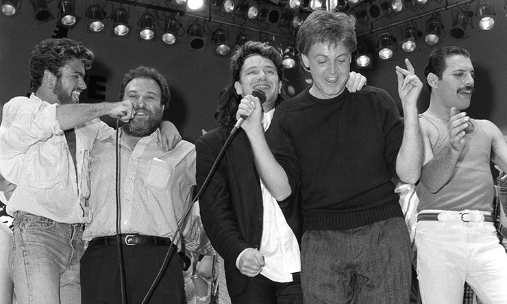 Paul McCartney, Bono, George Michael, Freddie Mercury and friend on stage at Live Aid