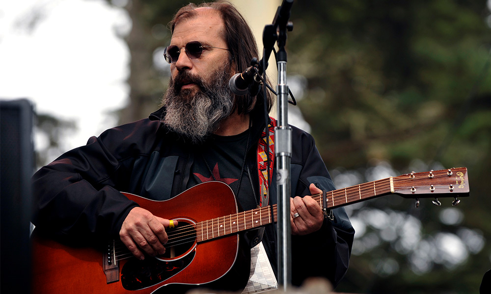 Steve Earle photo by Larry Hulst and Michael Ochs Archives and Getty Images