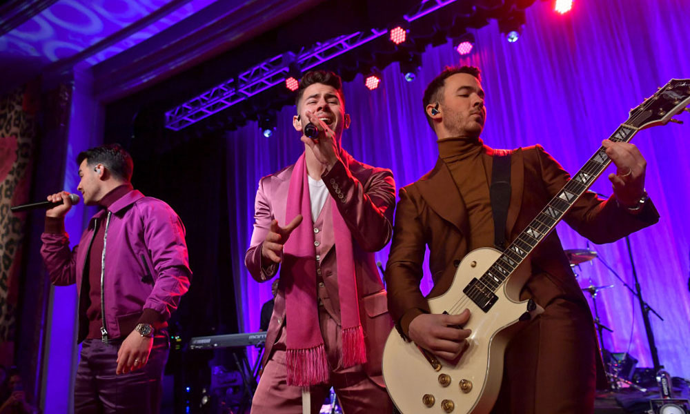 Jonas-Brothers-I-Need-You-Christmas-Lyric-Video